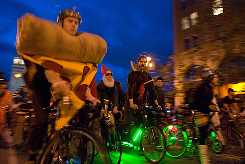 Halloween Critical Massers glowing to match the sky. Photo by Eduardo Green.