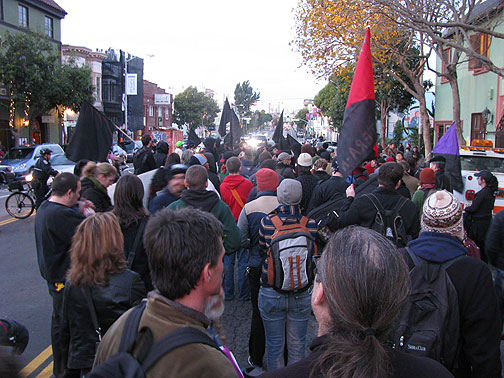 Demonstrators in solidarity with the Greek Uprising pause at New College on Valencia Street in San Francisco, Dec. 20, 2008.