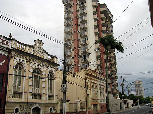 19th century low-rise structures, often covered in graffiti, sit side by side with typical highrise apartments.