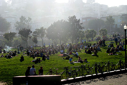 Winter light pours over Liberty Hill onto sunbathing denizens on the slopes above 19th Street in Dolores Park, Jan. 17, 2009.