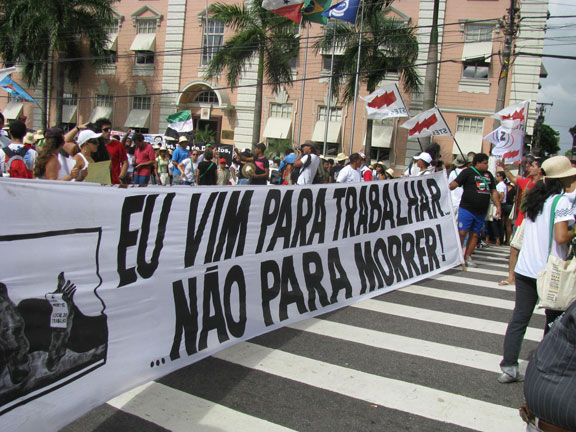 """I come to work, not to die!"" says the banner, at left end is the following cartoon."