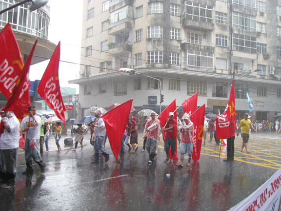 Soggy socialists march under a downpour, Jan. 26, 2009, Belem, Brazil, opening the World Social Forum.