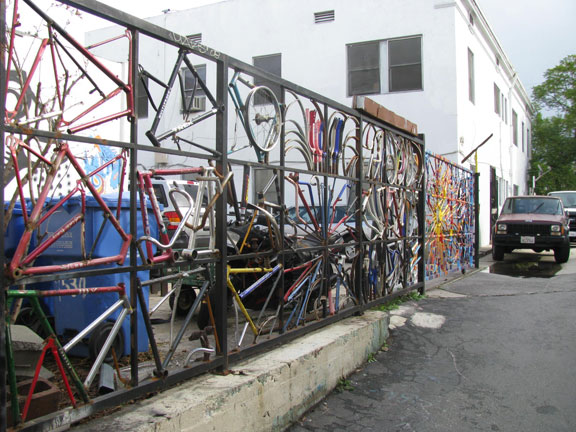 The new art-bike fence at LA Ecovillage.