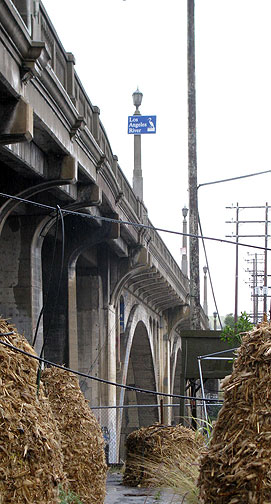 The historic Pasadena Viaduct soars over the FarmLab and the Los Angeles River.