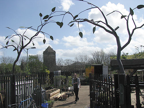 Looking back from the embankment, through the sculpture gate, towards the old church.
