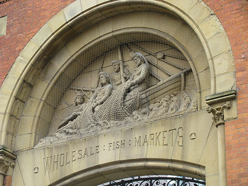 Old fish market facade, now enclosing a new office building.