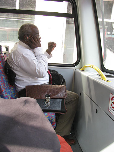 This Jamaican businessman was across from me at the top of a doubledecker bus, running his office from the front seat, while I was rolling northward for my lunch appointment.