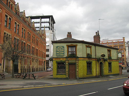 The historic pub is a favorite of Manchester United hooligans... surrounded by new development and redeveloped old buildings.