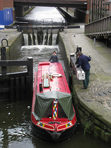 Local canal boat makes its way through a lock.