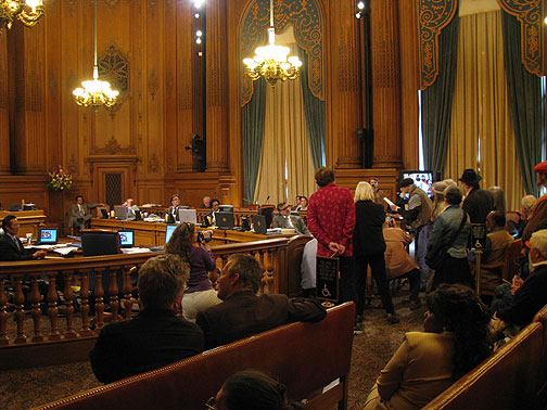 "John Ross at podium addressing San Francisco Board of Supervisors, refusing his ""day""."