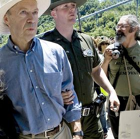NASA scientist James Hansen (left) gets busted protesting coal. (Photo: Rainforest Action Network)