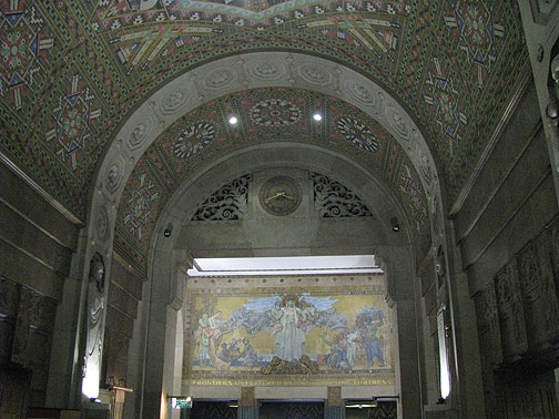 "The lobby is full of Indian motif deco and some mosaic murals... through the arc the slogan on the mural says: ""Frontiers Unfettered by any Frowning Fortress."""
