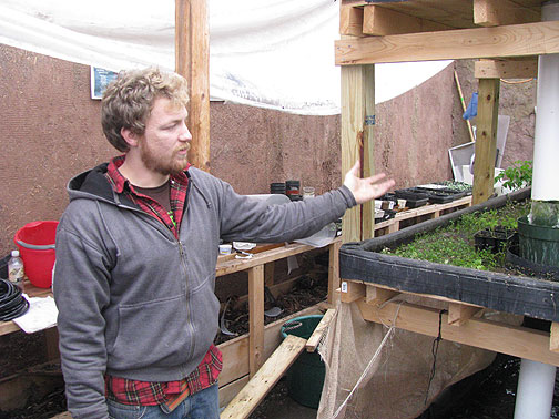 Jesse Meeder explains how the water circulates from one area to another in his fish farm.