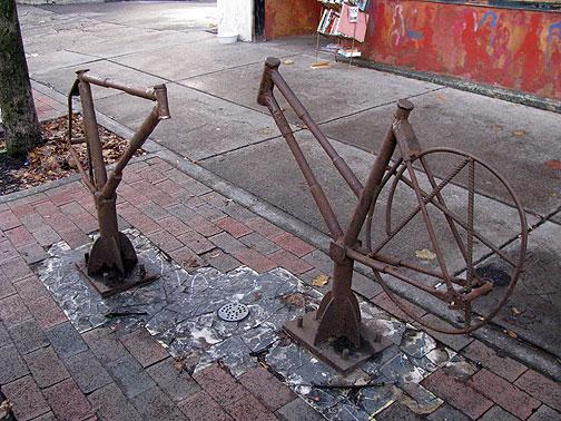Cool rusting bike racks in front of Rust Belt Books.