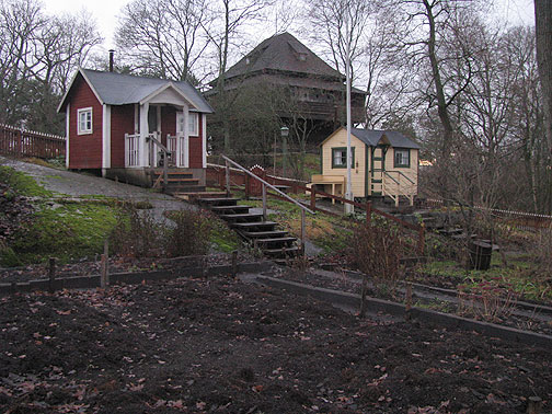 In Skansen museum, these are allotment huts, aka community gardens with small shacks, one from WWI era and the other from the 1940s.