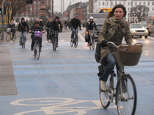 A typical scene of cyclists crossing the Norrebro Bridge in Copenhagen.