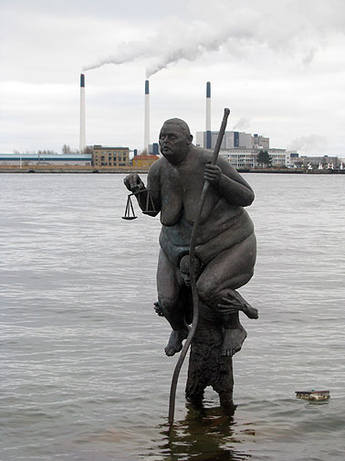 "Jens Galschiot put Justitia in the water a few meters from Copenhagen's famous Little Mermaid statue. ""I'm sitting on the back of a man--he is sinking under the burden--I will do everything to help him--except to step down from his back."" Justitia, Western Goddess of Justice... see more of his amazing work at www.sevenmeters.net."