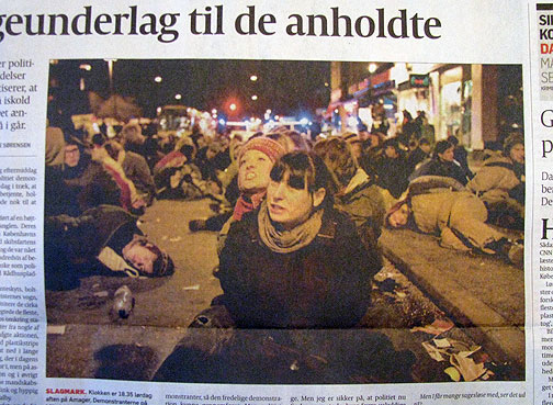 "From the local paper, arrestees held on street for 3 hours with no bathrooms, drink, or food, in freezing temperatures. A young Swede told us how neighbors hung red curtains and blankets out the windows in solidarity, that one person set up a projector and projected ""Let Them Go"" on the opposite wall, and another neighbor played loud music into the street. At least two demonstrators were hustled into someone's home to avoid arrest too!"