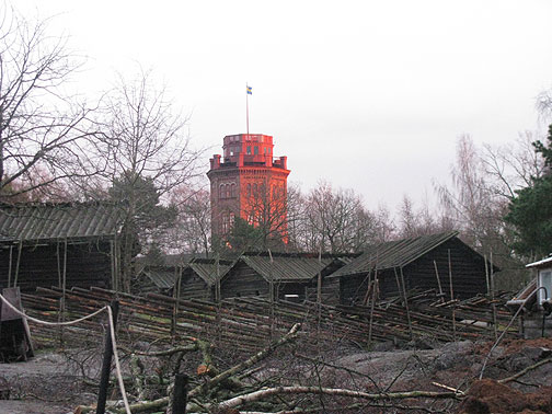 Setting sun on tower in Skansen, an open-air museum of historic Swedish buildings.