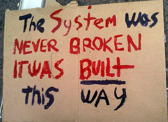 http://www.nowtopians.com/wp-content/uploads/2011/10/the-system-was-never-broken-it-was-built-this-way.jpg#greed%20is%20the%20main%20problem%20576x421