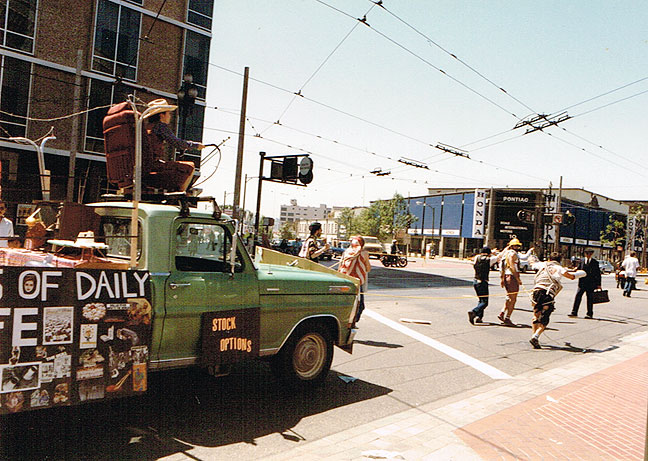 "Greg's green pickup as the ""Prisoners of Daily Life"" float at the May 1984 End of the World's Fair."