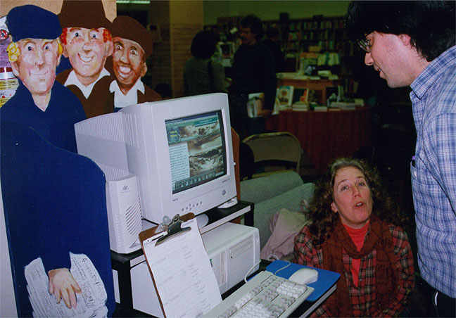 "A better view of the first kiosk, art of the three ""newsies"" who grinned from behnd the computer by Mike Mosher."