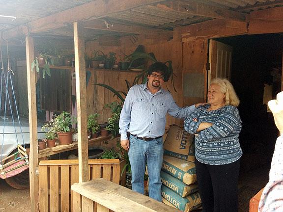 Bruno and Dona Isufina at block F of Nova Primaveira.