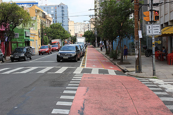 I was in Porto Alegre for the 1st World Bike Forum in 2011, which was held on the 1st anniversary of a mad businessman driving through Critical Mass at full speed along this street. There is now a dedicated, separated cycletrack on this same street. Looks like progress to me!