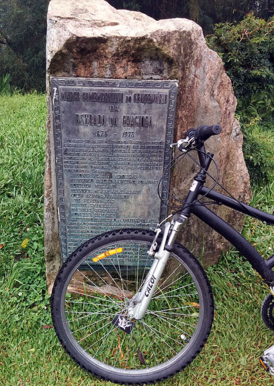 Monument to the building of the Serra da Graciosa road in the 1870s, here with one of our 70+ bikes in front.