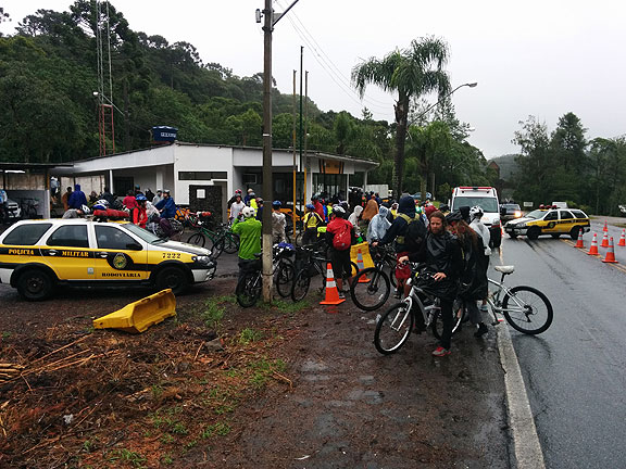 Arbitrary petty authority by the Brazilian federal police held our ride up for two hours at the head of the road. No laws were in play, just the opinion of a couple of cops who thought they had the right to ban  bicyclists from making the ride down the hill! They finally relented.