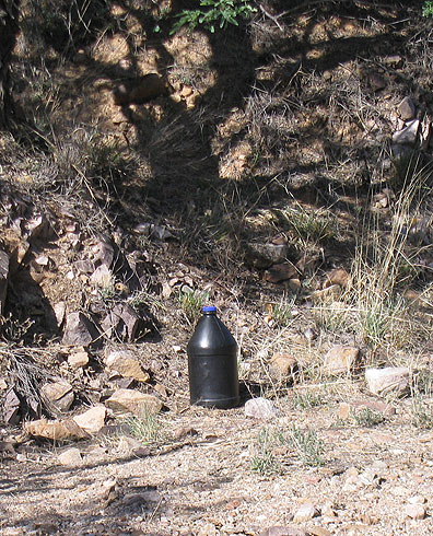 Migrants generally carry water bottles painted black so they won't be seen by spotlights during night crossings.