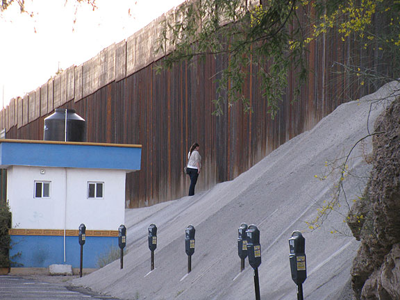 Carmen inspects border fence.