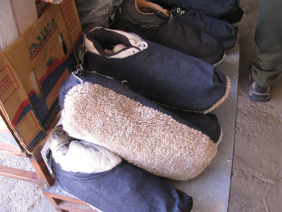 These slippers are sold to migrants to muffle their footprints.