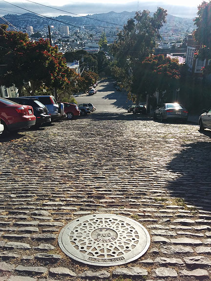 This and other manholes like it are on 24th Street just below Starr King open space where there are still cobblestones!