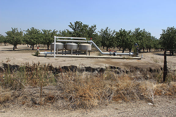 Aquifer pumps in almond orchard, keeping the California almond crop coming...