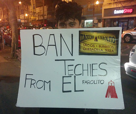 During the wild celebration last night in the Mission (after the Giants won their way into the World Series for the 3rd time in 5 years), this guy was protesting amidst the fun...