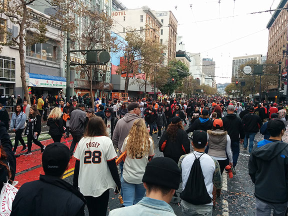 Giants fans clog Market Street after victory parade on Halloween.