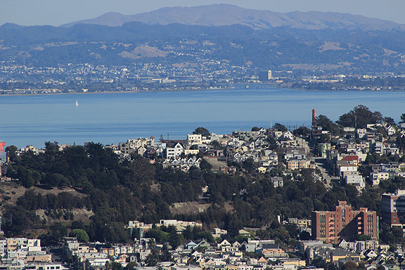 Weird view of Potrero Hill in the foreground and the Oakland Coliseum in the distance in the East Bay.