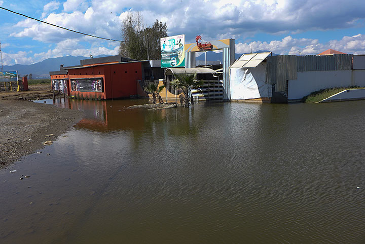 These businesses are indundated in their lakeside locales. The lake has recently been rising, but we weren't sure why.