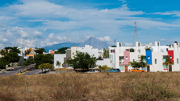 We drove north out of Colima past these modern housing projects, but with our thoughts on the volcano looming in the distance.