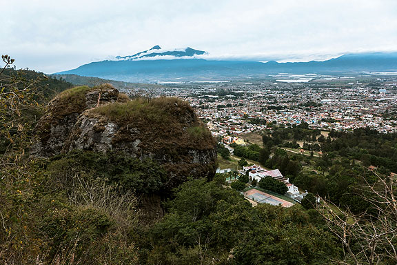 The long view across Ciudad Guzman. Where the city ends, the hothouses begin (for now)... Nevado de Colima in distance.