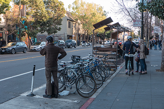 This parklet on Valencia in San Francisco features ample bike parking and cozy wooden benches.