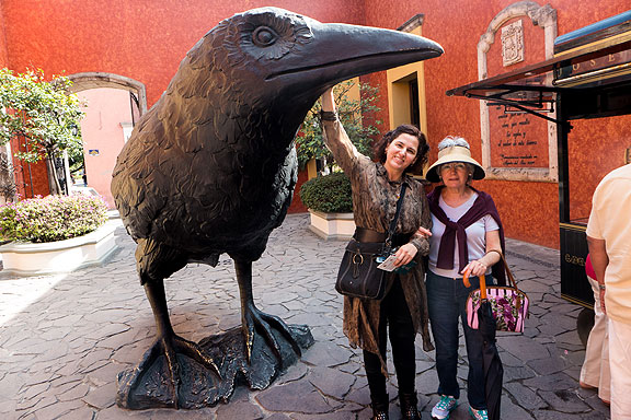 "Adriana and her mom under the ""cuervo"" at Jose Cuervo's fancy-schmantz tequila factory and tourist center (rather Disney-ish, actually)."
