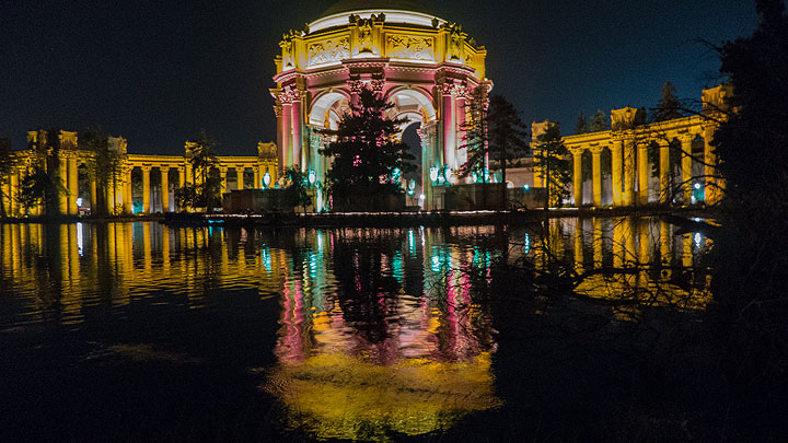 The Palace of Fine Arts lit up on the opening night of the centennial to match the lighting scheme that left such an impression a century ago.