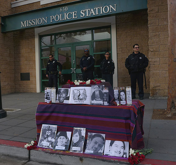 An Altar was placed in front of the police station during the People's Trial, holding the names of many victims of police murder.