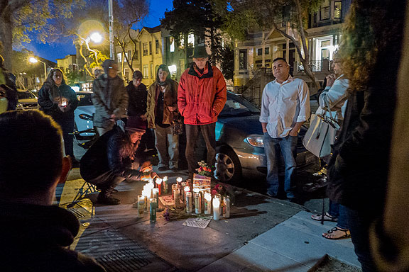 Neighbors hold a vigil on February 28, two days after Guatemalan immigrant Amilcar Perez-Lopez was shot dead by an undercover San Francisco cop.