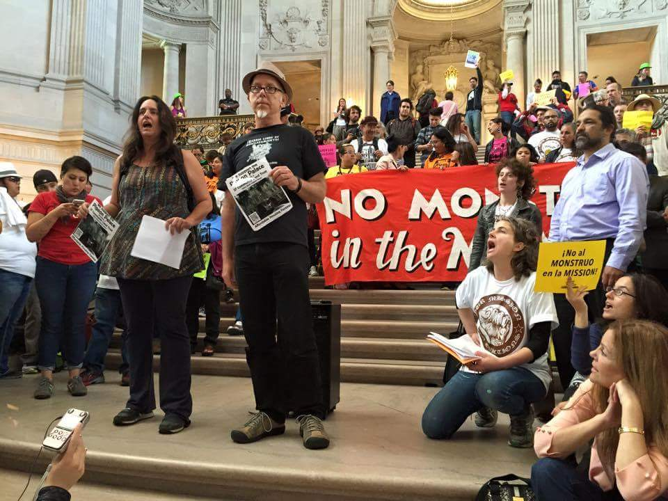 Carin McKay and Chris Carlsson giving a rap about the Pigeon Palace at the City Hall protest May 8, 2015.