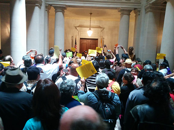 "After several loops the demonstration settled in front of Mayor Lee's locked office. He never made an appearance... the one-time tenant activist and now tech-booster and virtual Neoliberal couldn't even be bothered to meet with Mission activists who came to his door... moreover, the police and sheriff had closed the steps to protests with barricades and narrowed entrance to small paths through orange cones... an unusual welcome to get at ""our"" City Hall, to say the least."
