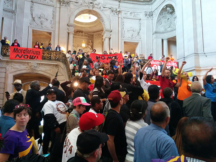 In City Hall rotunda, over a thousand gathered to demand a halt to evictions, a ban on further luxury housing construction, and the immediate commitment of millions per year to stabilize the Mission and provide affordable housing to all who need it, esp. those at 30% or below median income.