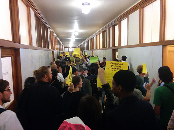 Outside Supervisors' offices, chanting!